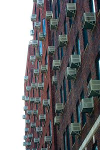 By Jason Kuffer from East Harlem, USA (Air Conditioners  Uploaded by Adrignola) [CC-BY-SA-2.0 (http://creativecommons.org/licenses/by-sa/2.0)], via Wikimedia Commons