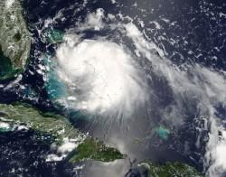Tropical Storm Katrina on August 24 2005 by NASA image courtesy Jeff Schmaltz, MODIS Land Rapid Response Team at NASA GSFC [Public domain], via Wikimedia Commons