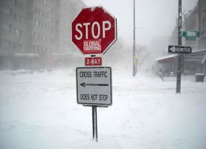 Stop_global_warming_sign_in_blizzard_-_February_10,_2010_blizzard