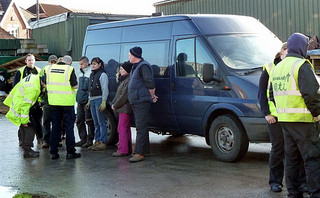 The UKBA enforcing the border in a non-educational workplace (UK Home Office, used under a Creative Commons share-alike agreement; from http://www.flickr.com/photos/49956354@N04/5413187108/)