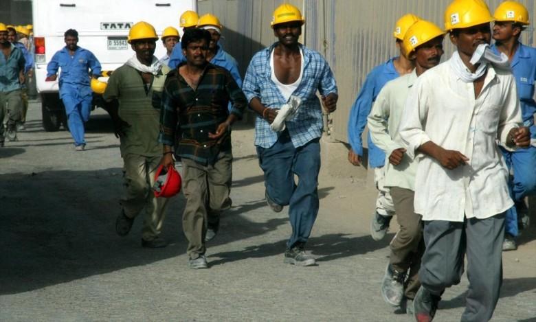 Construction workers at the Burj Dubai construction site in Dubai, United Arab Emirates