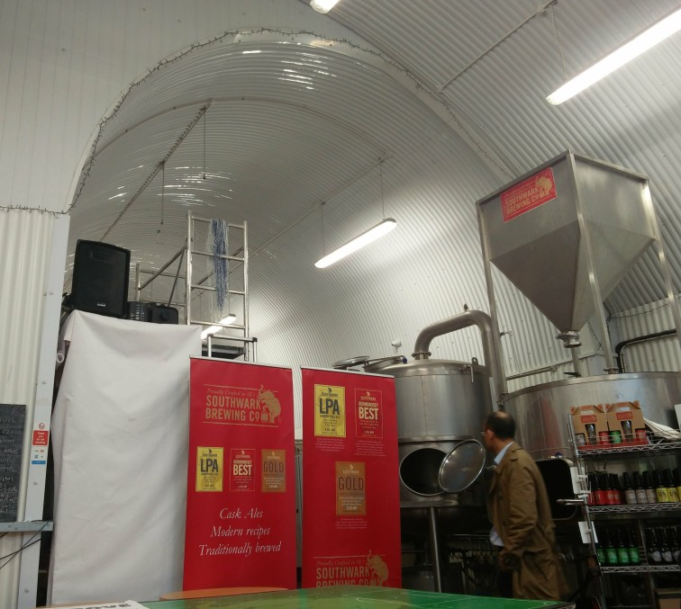 Brewing equipment inside a railway arch – note the corrugated metal coverings lining the arch installed by network rail to provide some protection from bare brickwork