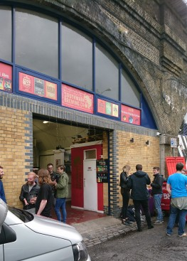 Drinkers outside one Bermondsey brewery, railway arch clearly visible