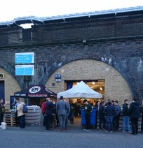 Beer Mile brewery with Friday evening drinkers taking advantage of the tap room. Note the street food stall to the left benefiting from the customers drawn to the brewery