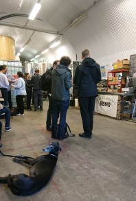 Drinkers (and 4 legged friends) enjoying beer in and amongst the brewing equipment of the brewery