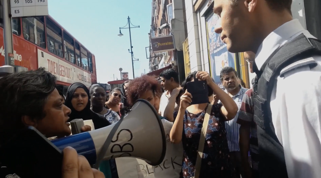 Still from the film Everyday Borders depicting a protest organised by women from the Southall Black Sisters. Everyday Borders was directed by Orson Nava and was produced as part of the EUBorderscapes project.